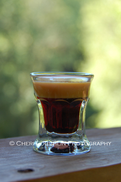 Baby Guinness layered shot is meant to mimic the look of a real Guinness beer when layered correctly. It is an easy two ingredient drink recipe.  – photo by Cheri Loughlin, The Intoxicologist