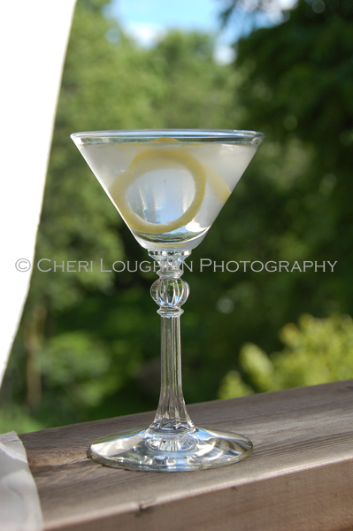 Martini - 2 ounces Gin (Vodka can be used), Dry Vermouth, Lemon Twist. - photo by Mixologist Cheri Loughlin, The Intoxicologist
