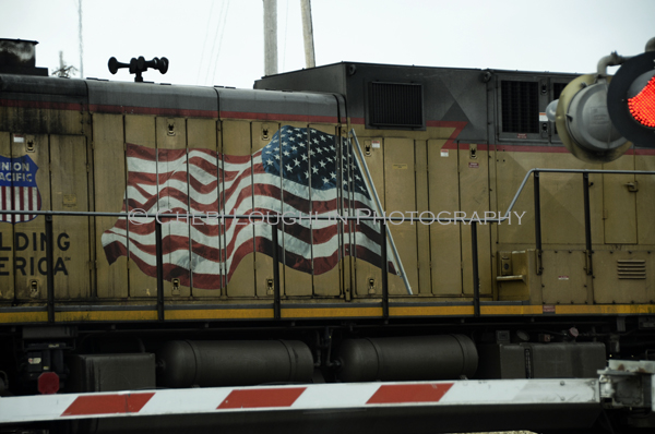 Train with Flag 012 - photo copyright Cheri Loughlin
