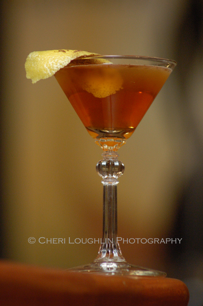 The Bobby Burns cocktail is named for the Scottish Poet, Robert Burns. This recipe is an adaptation by Omaha bartender, Chris Engles. His version uses a fabulous aromatic allspice and lemon twist garnish. - photo by Mixologist Cheri Loughlin, The Intoxicologist