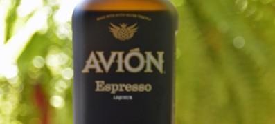 Avion Espresso Liqueur - Avion Tequila 020 Avion Espresso Liqueur taster shot with wooden bottle cap along side. - photo by Mixologist Cheri Loughlin, The Intoxicologist