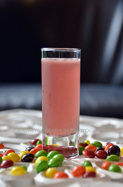 Skittle Shot is a fun candy themed shot ideal for Halloween parties, celebrating PINK for Breast Cancer Awareness month and of course raising a toast to National Vodka Day. - photo credit to Mixologist Cheri Loughlin, The Intoxicologist