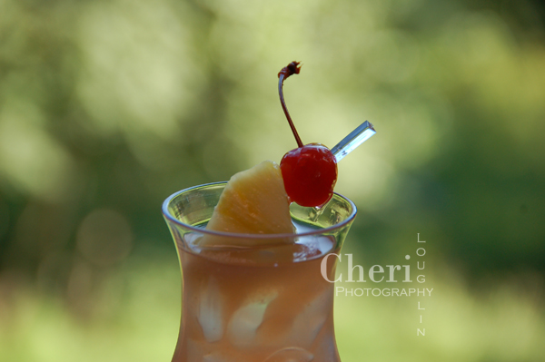 Swaying Winds vacation drink with spiced rum, coconut rum, mango rum, coconut, apricot, cranberry and lime. {recipe and photo credit: Cheri Loughlin}